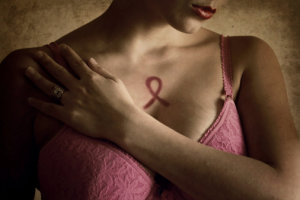 woman-with-breast-cancer-tattoo-on-her-chest