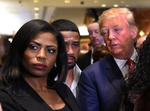 "Omarosa Manigault (L) who was a contestant on the first season of Donald Trump's ""The Apprentice"" and is now an ordained minister, appears alongside Republican presidential hopeful Donald Trump during a press conference November 30, 2015 that followed Trump's meeting with African-American religious leaders in New York. AFP PHOTO / TIMOTHY A. CLARY / AFP / TIMOTHY A. CLARY (Photo credit should read TIMOTHY A. CLARY/AFP/Getty Images)"